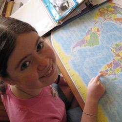Natalie consults an atlas
