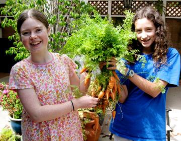 Natalie and friend in her garden